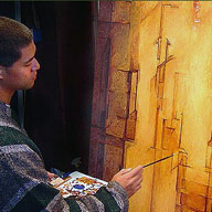 Artist Arnold Chao in hist art studio painting an abstract oil painting