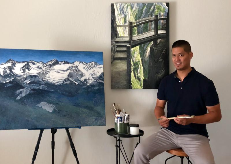 Artist Arnold Chao with his oil paintings in his San Francisco Bay Area art stud